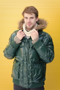 Young blond man in ski parka